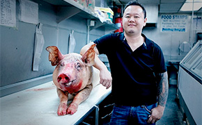 Jet Tila and a heritage pig at Cochon 555 in 2013