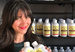 Robin Christenson of Blinking Owl Distillery with her Hand Sanitzer
