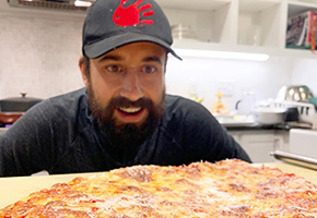 Chef Andrew Gruel savoring a New Jersey style Pizza